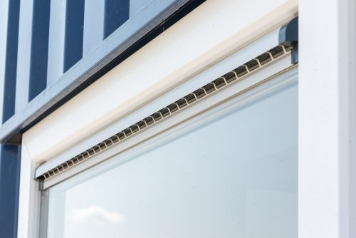 Fixed glass window frames with ventilation grille