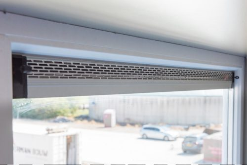Fixed glass window with ventilation grille